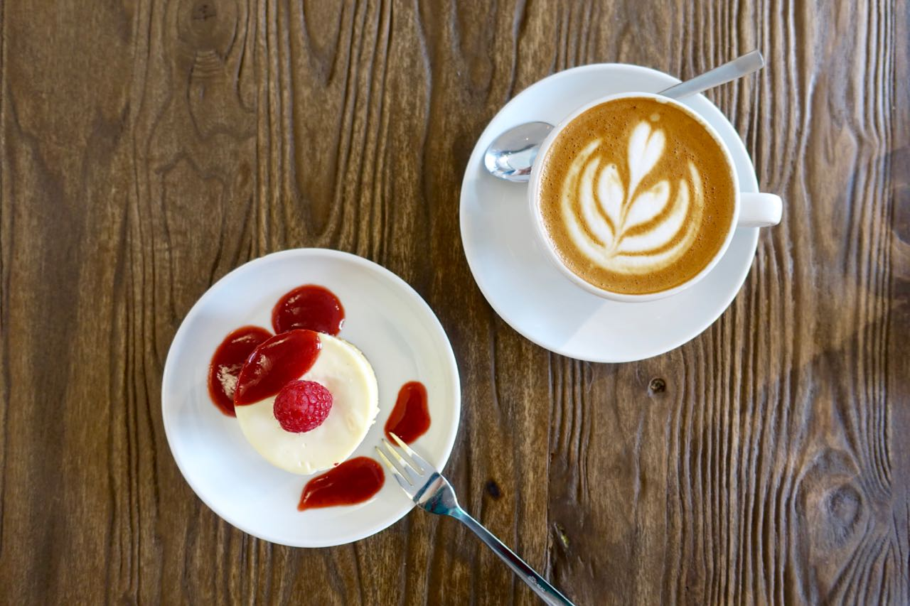 Flat White and Cheesecake at Nord Coast Coffee Roastery