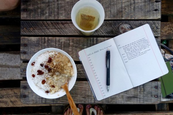 breakfast rice porridge, tea, notebook